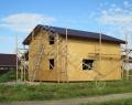 Каркасный дом, каркас зашит, кровельное покрытие из металлочерепицы выполнено