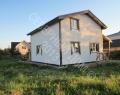 Каркасный дом, строительные леса сняты